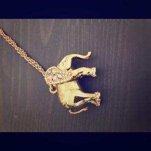 Long elephant necklace.